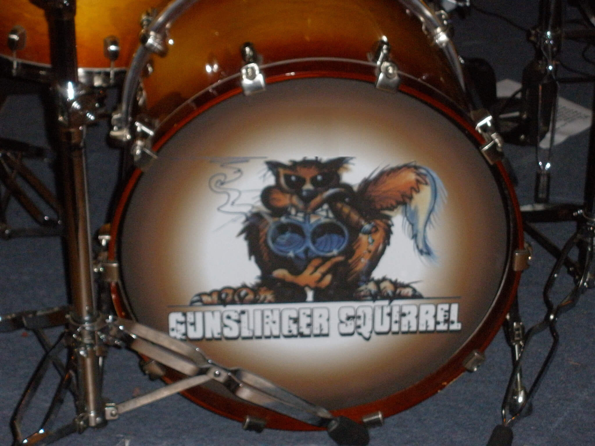 Gunslinger Squirrel, removable drum decal, kick drum skin, full color drum decal, drum skin, sale, cheap price, die-cut, die cut vinyl decals, reusable static cling drum decal, music bands, local band